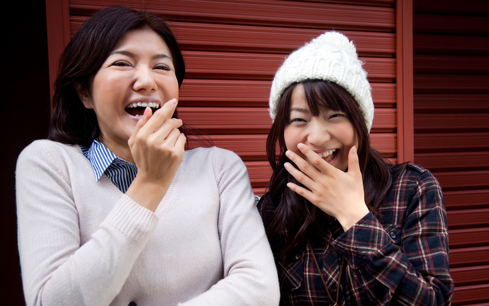 Why do Japanese women cover their mouth while laughing?