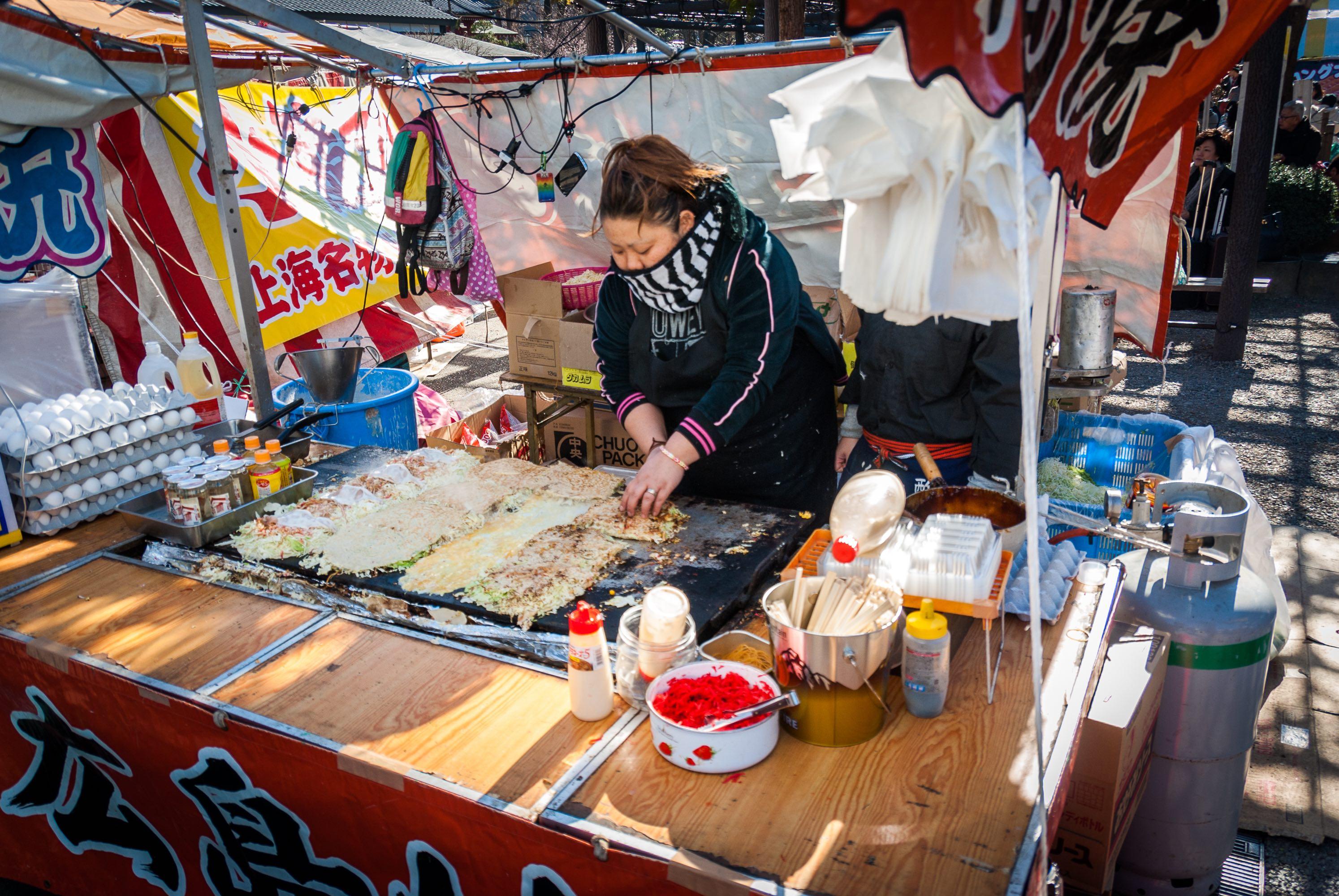 Japanese woman making okonimiyaki