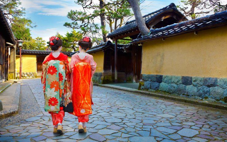 Japanese maiko walk in Kanazawa, Japan.