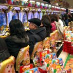 A row of players playing pachinko. Are casinos in Japan an unnecessary gamble?