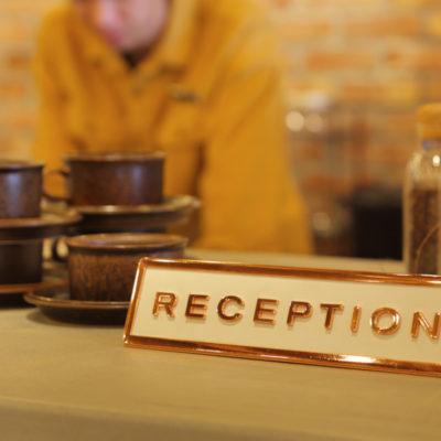 Unwind Hotel & Bar reception sign