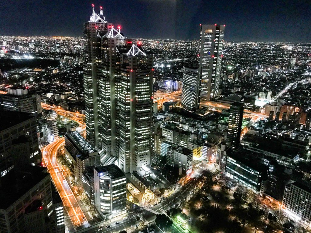 Shinjuku Park Tower as seen from the South Observatory of the Tokyo Metropolitan Government Building at night.