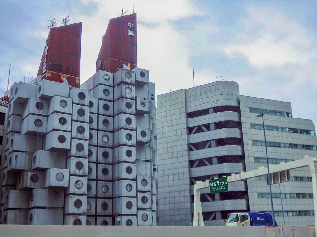 Nakagin Capsule Tower seen across the Tokyo Expressway (Route 316). Nakagin Capsule Tower seen across the Tokyo Expressway (Route 316).
