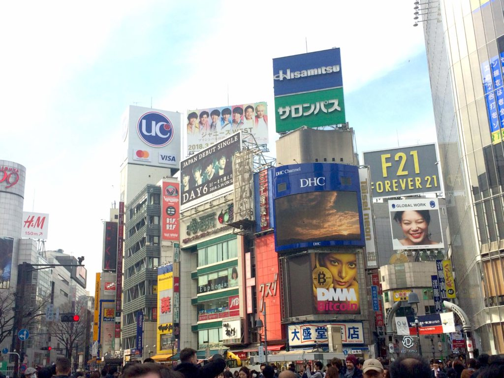 Can you spot the giant bitcoin ad near the Shibuya scramble crossing in Tokyo? (Photo taken in early March 2018.)