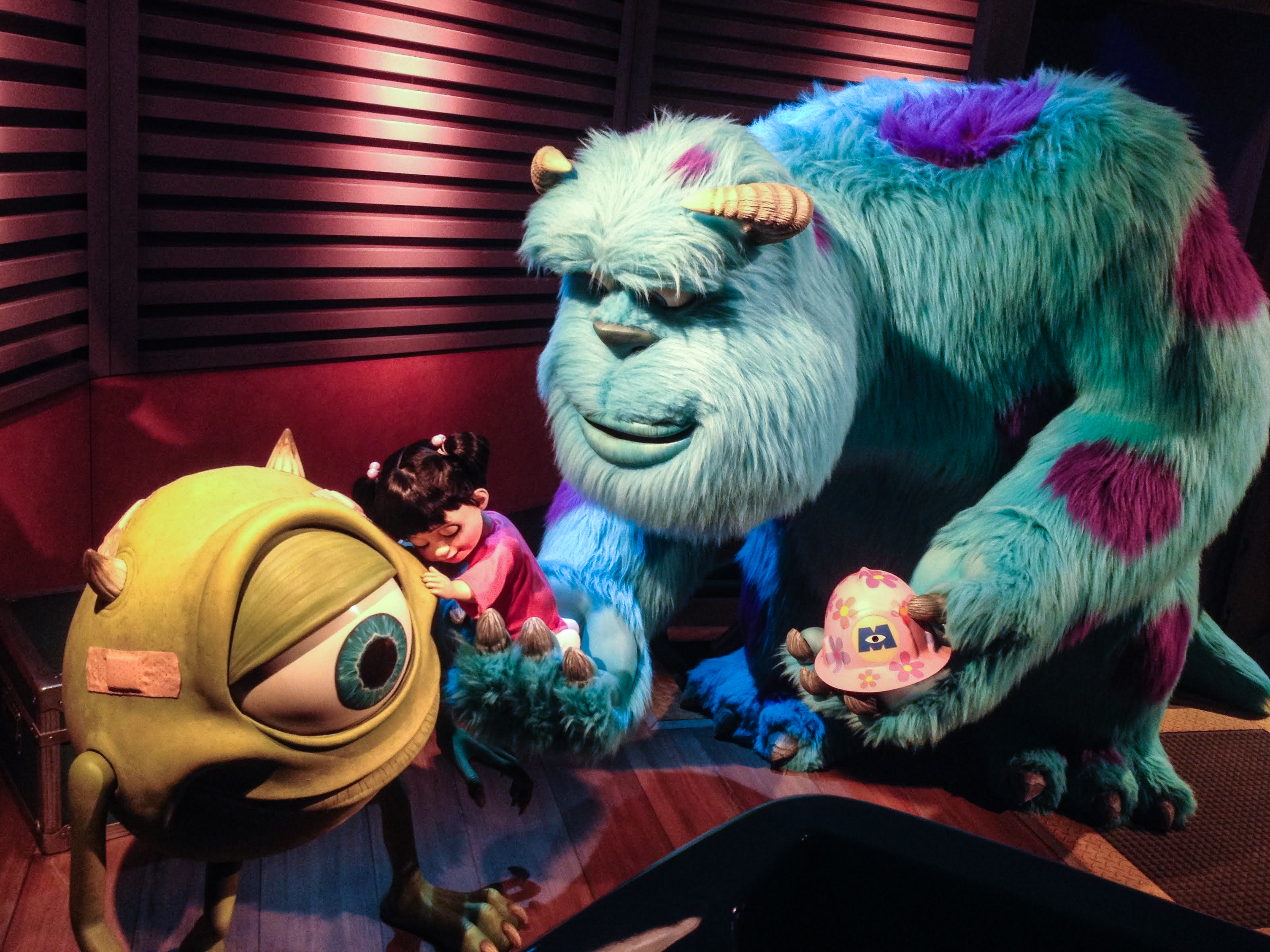 The characters Mike, Sully, and Boo in Monsters, Inc. Ride and Go Seek!