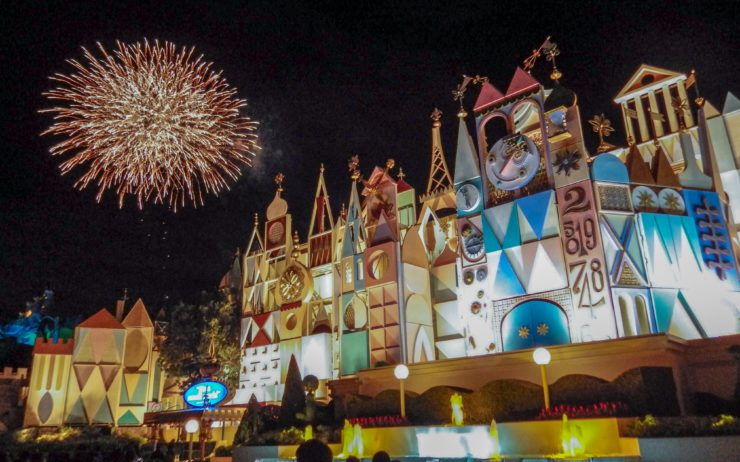 Fireworks going off outside It's a Small World at Tokyo Disneyland.