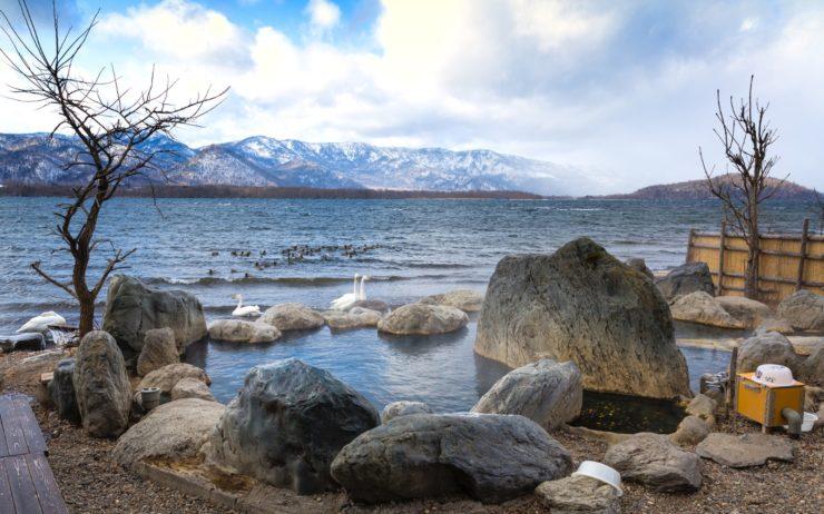 the warm waters of the Kotan Onsen open-air bath. Teshikaga, Hokkaido.