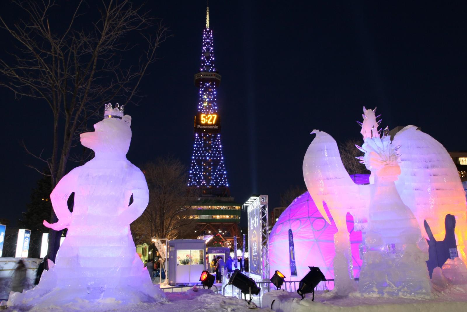 Sapporo Snow Festival lit up sculptures.