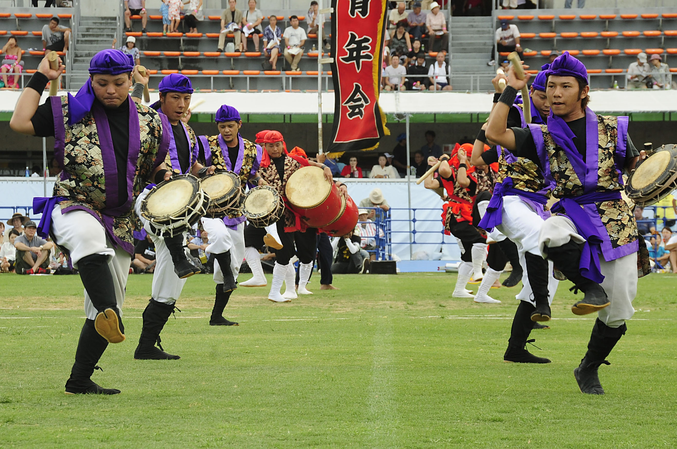 A Taiko drum group performs for the crowd during the 58th Okinawa Zento Eisa Festival in Koza Athletic Park.