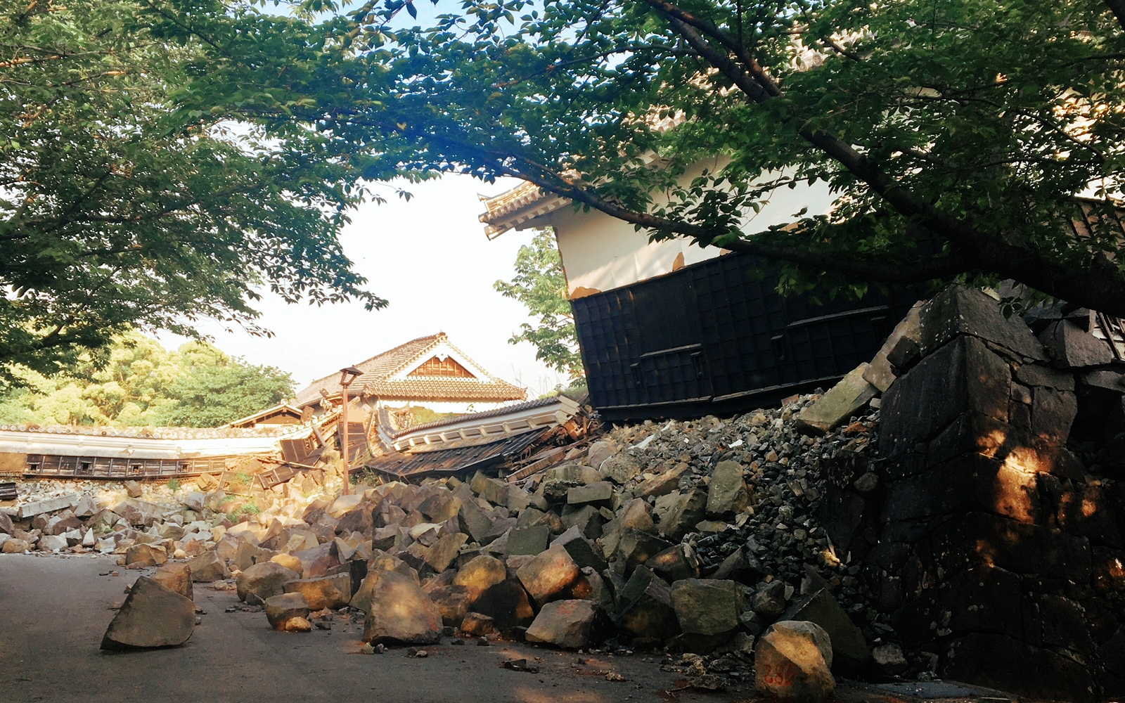 Restricted entry near a collapsed structure on the grounds of Kumamoto Castle.