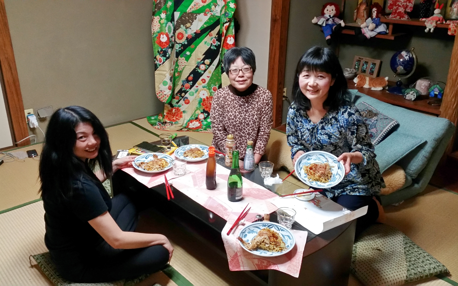 Homemade okonomiyaki and sake with our hosts in Mihara.