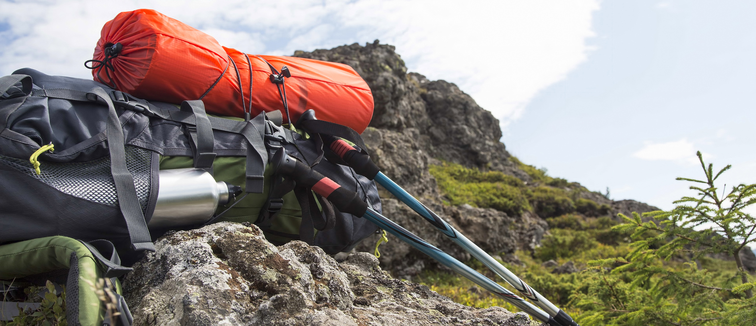 Mountain hiking equipment with backpack.