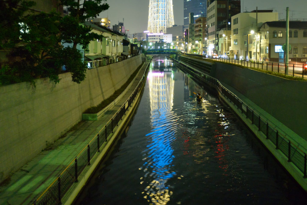 Canoeing through Tokyo is a unique way to see the city at night
