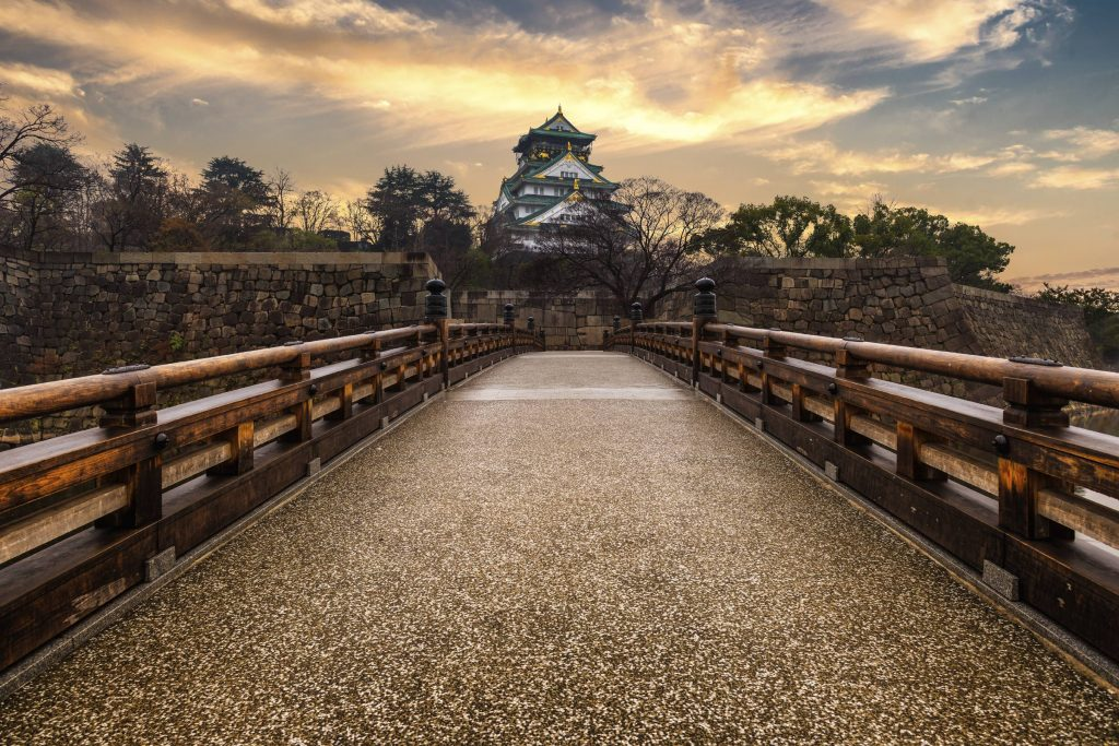 Visit the landmark Osaka castle for a glimpse into the city's feudal past.
