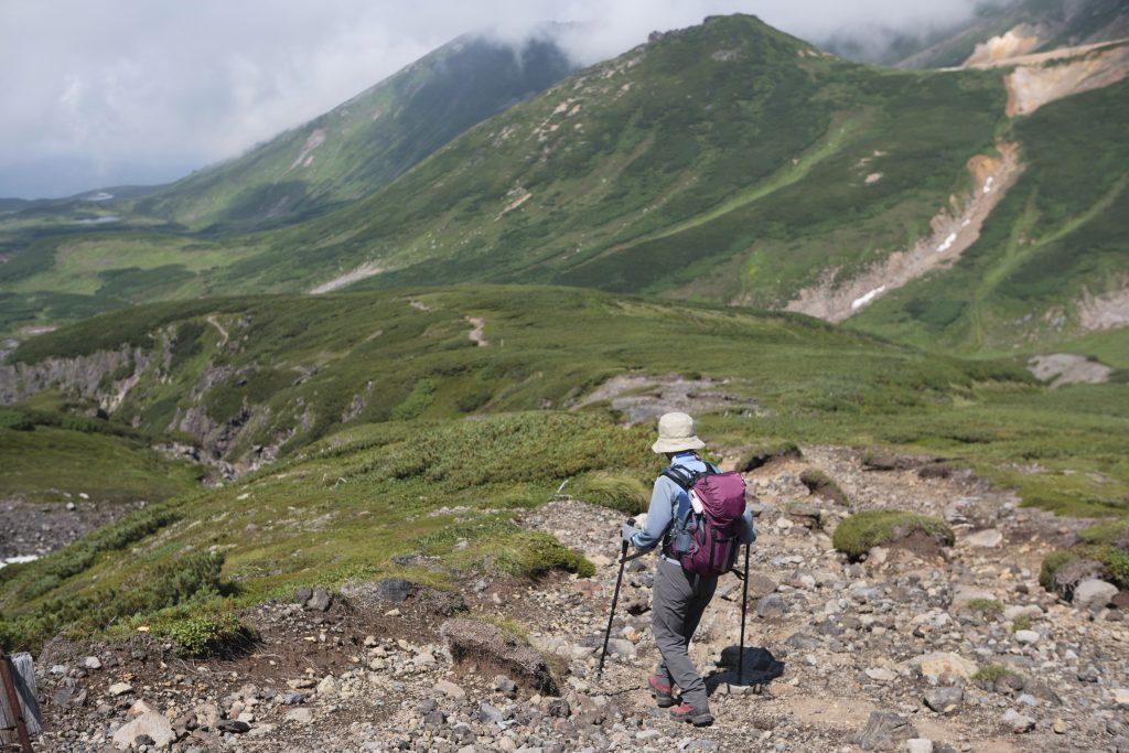 """""""A trekker walking down a trail in Daisetsuzan National Park in Hokkaido, Japan"""""""