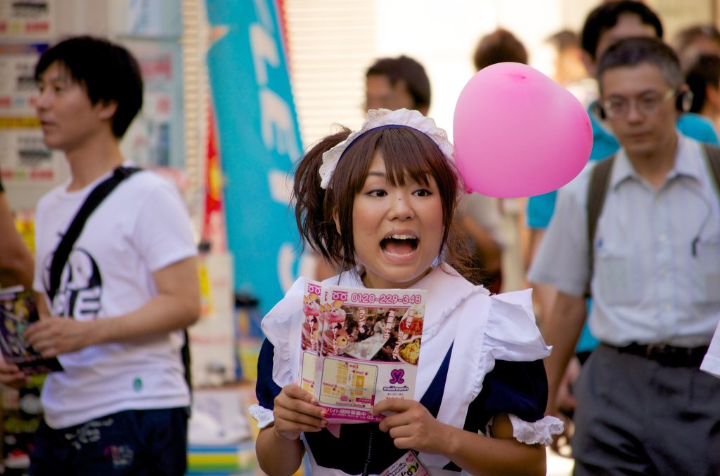 A maid working outside a maid cafe in Akihabara.